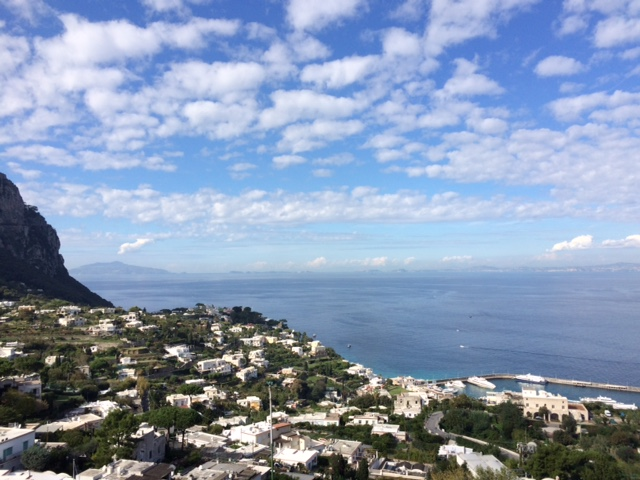 The clouds scudded across the azure sky in a perfect picture over the Mediterranean Sea.
